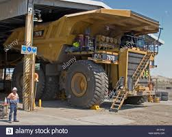Mine Worker / Truck Driver Dwarfed By Huge Mining Dump Truck In ...