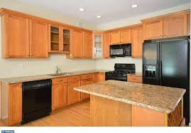 contemporary kitchen with hardwood floors built in bookshelf in