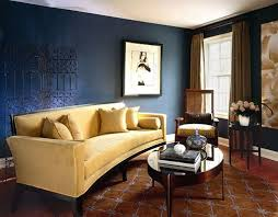 interior design picture of navy blue living room with tufted sofa