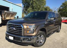Tan 2015 Ford F150 XLT With Color Match Leer Truck Cap Installed ...