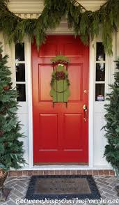Frontgate Christmas Trees Decorated by Mongrammed Door Mat From Frontgate