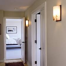 alabaster sconces adorn modern style hallway brass light gallery
