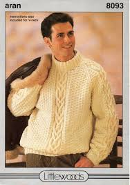 traditional aran cable pullover sweater has a crew neck and raglan