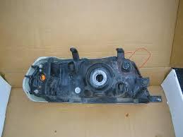 how do i adjust the headlights on a 2002 mitsubishi montero sport