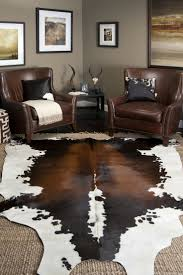 Brown Carpet Living Room Ideas by Accessories Brown Leather Armchairs With Cowhide Rug And Side