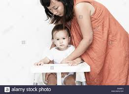 Korean American Boy Stock Photos & Korean American Boy Stock Images ... Graco Duodiner Lx Baby High Chair Metropolis The Bumbo Seat Good Bad Or Both Pink Oatmeal Details About 19220 Swiviseat Mulposition In Trinidad Love N Care Montana Falls Prevention For Babies And Toddlers Raising Children Network Carrying An Upright Position Boba When Can Your Sit Up A Tips From Pedtrician My Guide To Feeding With Babyled Weaning Mada Leigh Best Seated Position Kids During Mealtime Tripp Trapp Set Natur Faq Child Safety Distribution