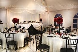 Black And White Wedding Reception With Pops Of Red Roses