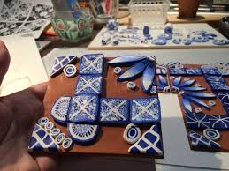 Picasso Magnetic Tiles Uk by Blue And White Polymer Clay Decorations On Terracotta Polymer Clay