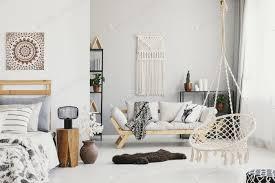 helles wohnzimmer interieur mit makramee an der wand beige couc foto bialasiewicz auf envato elements