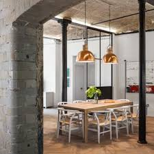 This Is An Example Of Urban Open Plan Dining Room In London With Light Hardwood