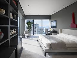 ApartmentsModern Simple Bedroom Apartment Design With White Comfortable Laminated Bedsheet And Plain Fabric