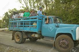 Group Of People Traveling In The Back Of A Truck In The Valle ...