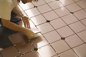 installing tile mastic on a concrete floor