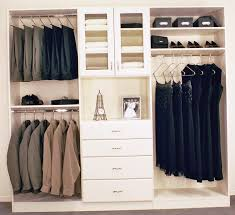 Wood Closet Systems Green Baskets Placed In White Shelves Beside Clothes Hangers For Minimalist Organizer Ideas