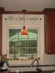 An Italian Kitchen Wall Quote Above The Window And In Between Cabinets