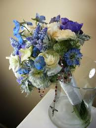 A beautiful bridal bouquet in tints tones and shades of blue