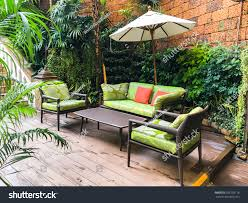 Cozy Sofa Coffee Table Umbrella Garden Stock Photo 599758118 ... Balinese Home Design 11682 Diy Create Gardening Ideas Backyard Garden Our Neighbourhood L Hotel Indigo Bali Seminyak Beach Style Swimming Pool For Small Spaces With Wooden Nyepi The Day Of Silence World Travel Selfies Best Quality Huts Sale Aarons Outdoor Living Architecture Luxury Red The Most Beautiful Pools In Vogue Shamballa Moon Villa Ubud Making It Happen Vlog Ipirations Modern Landscape Clifton Land Water