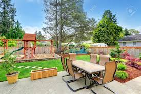 Backyard With Patio Area And Playground For Kids Stock Photo ... Landscaping Ideas Kid Friendly Backyard Pdf And Playgrounds Playground Accsories A Sets For Amazoncom Metal Swing Set Swingset Outdoor Play Slide For Children Round Yard Kids Free Images Grass Lawn Summer Young Park Backyard Playing Home Decor Design Steel Discovery Prairie Ridge All Cedar Wood With Patio Area And Stock Photo Refreshing Your Kids Carehomedecor Fun Ways To Transform Your Into A Cool Weston Walmartcom Backyards Bright Small Cream