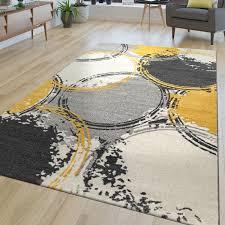 kurzflor wohnzimmer teppich gelb grau weiß ausgefallenes