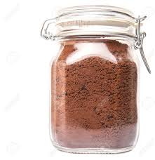 Instant Coffee Drink Powder In Glass Jar Container Over White Background Stock Photo