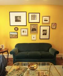 Cool Yellow Living Rooms Interior Wall Paint Color With Decorative Art And Black Sofa Also Glass Coffee Table