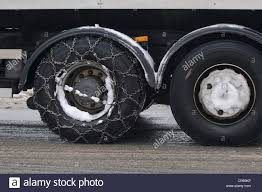 Winter, Truck With Snow Chains On The Drive Axle Stock Photo ...