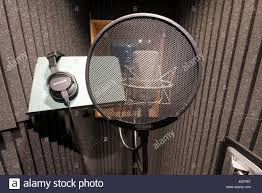 A Neuman Microphone In Vocal Booth Music Recording Studio With Pop Shield