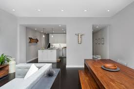dove grey paint living room modern with wood table new york apartment