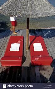 100 Hotel Casa Del Mar Corsica Red Sun Loungers And Beach Umbrella At Delmar