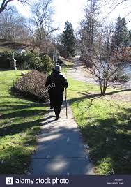 Man With Walking Stick Strolling Through The Mount Auburn Cemetery Cambridge MA