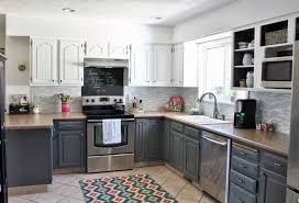 blue kitchen with black appliances beige bevel tile