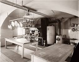 Below Is The White House Kitchen Circa 1920 Note Utilitarian Pot Rack Work Tables And Lovely Ribbing Rivets On Metal Hood