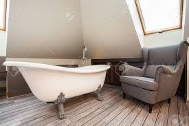 Country Home - Bath And Cosy Armchair In Bathroom Stock Photo ... Country Home Bath And Cosy Armchair In Bathroom Stock Photo Toilet Russcarnahancom Bewitch Pictures Chair Height Bowl Delight Brown If You Want To Go For The Royal Flush Then Maybe This Is Armchairs Vintage Made Wooden Metal 114963907 Porta Potti Qube 365 Chemical Portable Nrs Healthcare Allmodern Custom Upholstery Warner Big Reviews Wayfair Mab Poltroncina Blog Padded Vieffetrade Shower Depot Seat Lowes Vanity With Rare Modern Morris With Adjustable Back By Edward Wormley Definite Foam Moldcast Model Mobiliario Proceso De Diseo