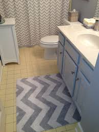 Yellow And Gray Chevron Bathroom Set by Grey Chevron Rug And Shower Curtain To Update Yellow Tile Bathroom