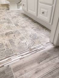 mosaic transition between gray wood look porcelain tile and brick