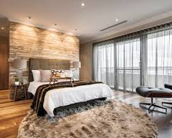 Trendy Master Medium Tone Wood Floor Bedroom Photo In Perth With Gray Walls