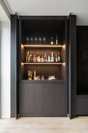 Pivot sliding doors conceal the bar