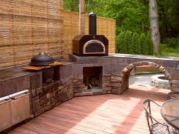 Beautiful outdoor kitchen with the Mario Batali Etna Grande wood