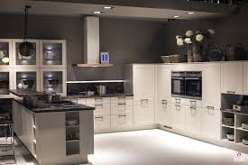 White Cabinets Dark Countertop What Color Backsplash by White Cabinets Gray Island With Dark Countertop Doublw Wall Ovens