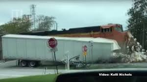 Watch A Freight Train Slam Into A Tractor-Trailer Truck Filled ... Daimler Demonstrates Driverless Tractor Trailer Wsj Trailer Carrying Titos Vodka Overturns Closes I95 Ramp Image Of Truck Catholic Man Night Supagas Ebh Tctortrailer Trucks Pinterest Kenworth Watch Commuter Train Cuts Fedex Truck In Two Crash Peoplecom Ctortrailer Driver Traing 4th Edition Worlds First Selfdriving Tractor Unveiled Toronto Star Photo Collection Semi How Much Weight Can A Haul Nevada Big Rig On A Mountain Road Stock Driving School Melt Program Baltimore Collision Repair Services Archives