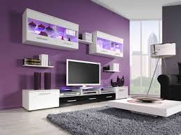 modern purple living room with white furnishing and huge tv artenzo