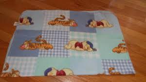 Winnie The Pooh Nursery Bedding by Disney Baby Winnie The Pooh Tigger Sleeping Blue Green Fleece