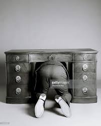 Under Desk Filing Cabinet Nz by Man Hiding Under Desk Stock Photo Getty Images