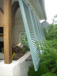 Bermuda Shutters On A Porch. | Lin Inn | Orangery /Screened Porch ... Clamshell Awning And Blinds For Patio Ideas Lime Residential Awnings Privacy Sash Windows Window How To Get Best Plantation Shutters And In Sydney Wikipedia Showin S35 Tubular Actuator 35 230v Motor For Roller Shutters Bahama From Thompson Dollar Curtains External Alinium Exterior Design Diy Sizes Central Coast Mastercraft Canvas Bunnell Fl