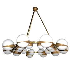 globe chandelier with white glass balls on brass frame for