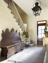 The Entryway Of This Country Home Is A Charming Place For Rustic Handcrafted Wooden Bench And Fringed Cotton Rug Large Wrought Iron Lantern Lovely