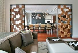 Panels Of Stacked Wood Blocks Add A Graphic Look To The Area Dividing Living Room And Dining Image Betty Wasserman