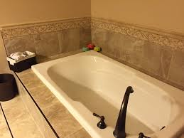 master bathroom remodel featuring porcelain tile with rubbed