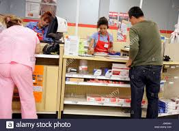 Miami Florida fice Depot Hispanic woman women man cashiers Stock