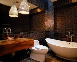small black tile wall with large mirror combined with brown tile